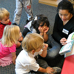 teacher reading book to children at Children