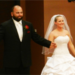 Mr. and Mrs. Salas at their wedding in the Parma Payne Goodall Alumni Center.