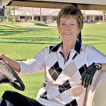 Diane Dodgion Denkler seated in golf cart.
