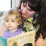 A woman reading to a child