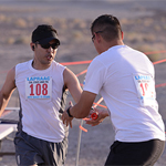 CSU Northridge Detective Mark Benavidez hands off the baton to runner David Olivares, a parking officer from CSU Long Beach.