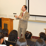 Hirshman speaking to students