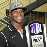Athlete posing with MW trophy