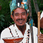 An Ecuadorian man poses with a mucawa — a special bowl used to drink chicha, an Ecuadorian delicacy.