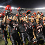 Aztec football players singing the fight song after a victory