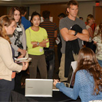 Students and educators are shown a new program involving laptops and tablets.