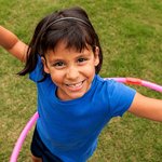 Young Latina girl with hula hoop