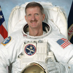 Former astronaut Joseph R. Tanner, mission specialist.