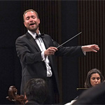 SDSU Director of Orchestras, Michael Gerdes, conducts the SDSU Symphony Orchestra.