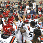 Aztec football players celebrate after a game