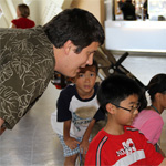 An SDSU CRMSE student works with local children at the 2013 Science Expo
