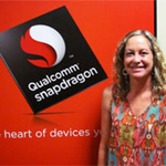 Anita Hix stands next to a Qualcomm advertisement