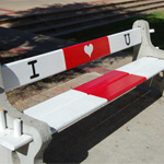 """I Heart You"" benches are located between the Don Powell Theatre and the Music building."