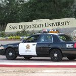 SDSU police car in front of the SDSU sign