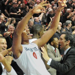 A basketball player celebrating after the game
