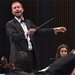 Michael Gerdes conducts an orchestra