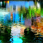 Colored light reflections on water