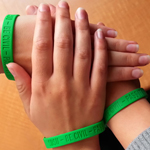 SDSU students hold out their wrists with Be Civil Campaign bracelets