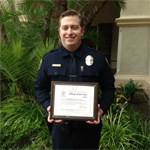 Matt Smith SDSU Police Officer holds award