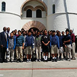 Andre Branch with students outside Hepner Hall