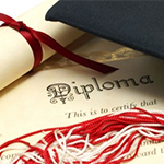 A diploma and graduation cap