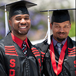 Two men in graduation gard
