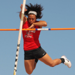 A woman pole vaulting