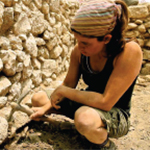Woman digging in Jerusalem