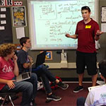 Andrew Ingle working with students at Pride Academy in Santee