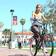 Woman bikes on campus