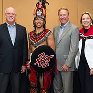 Leaders of Sempra, SDG&E and SDSU pose with the Aztec Warrior.
