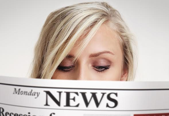 A woman reading the news.