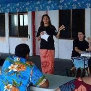 SDSU assistant professor of geography Arielle Levine (standing) facilitates a mapping workshop in American Samoa.