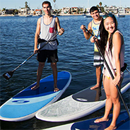 Students stand-up paddle