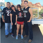 Guy, Francie, Lauren and Max Louie on their way to an Aztec football game.
