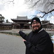 Enrique Munoz, a previous SDSU Gilman Scholar recipient, stands in front of the Byodo-In Temple in Japan.