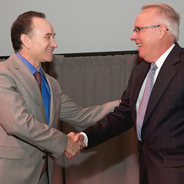 President Elliot Hirshman shakes hands with William Yeager, one of this year
