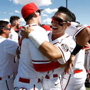SDSU baseball players celebrate winning the Mountain West championship after their 5-3, comeback win against Fresno State on May 28.