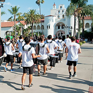 The SDSU marching band leads the Band Run toward Hepner Hall.