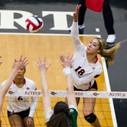 SDSU outside hitter Alexis Cage (#18) attempts a spike during a match earlier this season. (Photo: Derrick Tuskan/GoAztecs)