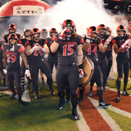 The Aztecs make their entrance to the field. (Photo: Ernie Anderson/GoAztecs)