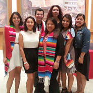 Undocumented Resource Area coordinator Cynthia A. Torres (back) with students