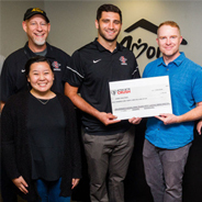 Josh Bringuel presenting a check to the Amor Ministries in San Diego.