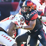 SDSU linebacker Kyahva Tezino makes a tackle against the University of New Mexico last season.