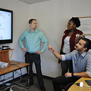 Math education professor Daniel Reinholz works on the EQUIP app with two doctoral students, Amelia Stone-Johnstone and Antonio Martinez.