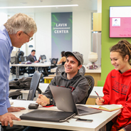 Alex DeNoble, director of the Lavin Entrepreneurship Center, in class with Chad Vardas, left, Paige Doherty and Michael Kosoff