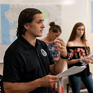 Homeland Security Graduate Program student Terence Leahy provides a briefing during the end of semester EOC exercise for HSEC 603. Photo credit: Gary Payne.