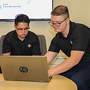 Computer science majors Robert Carpenter,  Reidun Dirawatun and Jeremy Goold working on their math learning app at the ZIP Launchpad. (Photo: Scott Hargrove/SDSU)