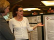 A student presents her poster at last year