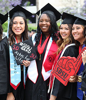Women celebrating at a 2014 SDSU Commencement ceremony.